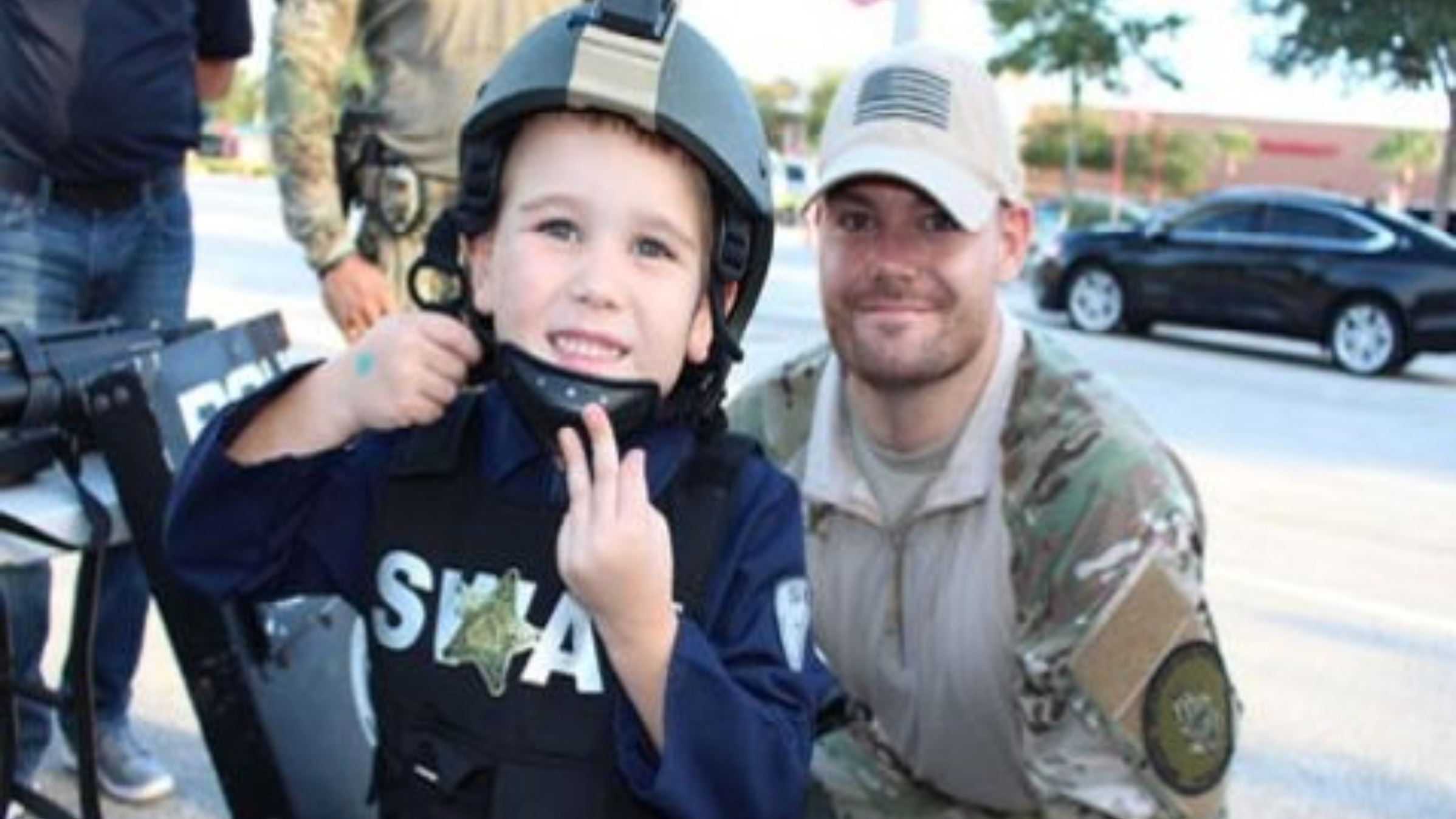 SWAT Officer with a Child Dressed in SWAT Gear
